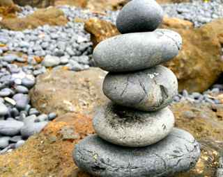 Rock cairn representing self care balance